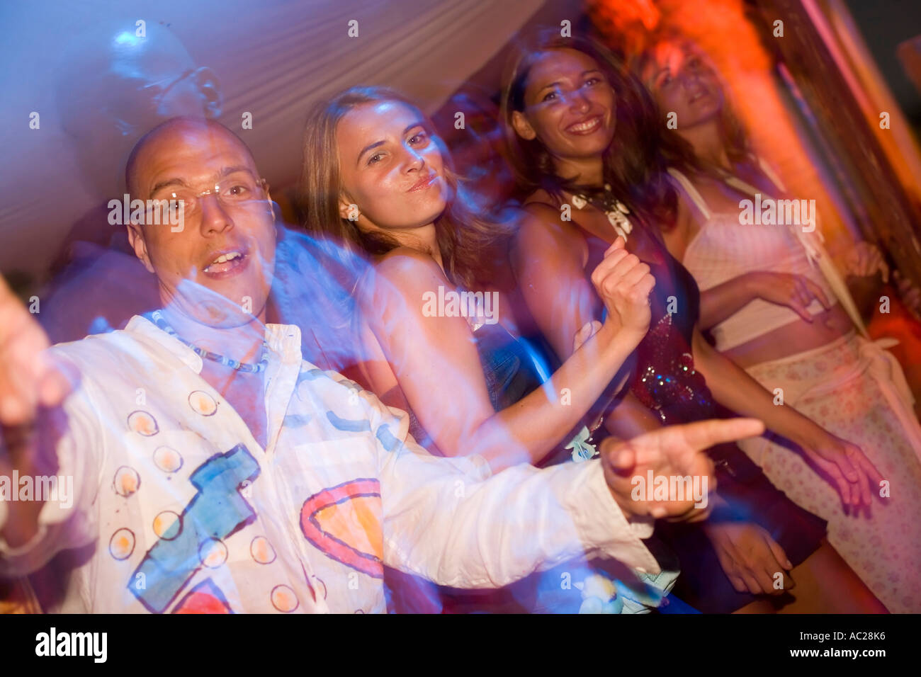 Young grils dancing by the full moon party of the Paradise Club Paradise Beach Mykonos Greece - Stock Image