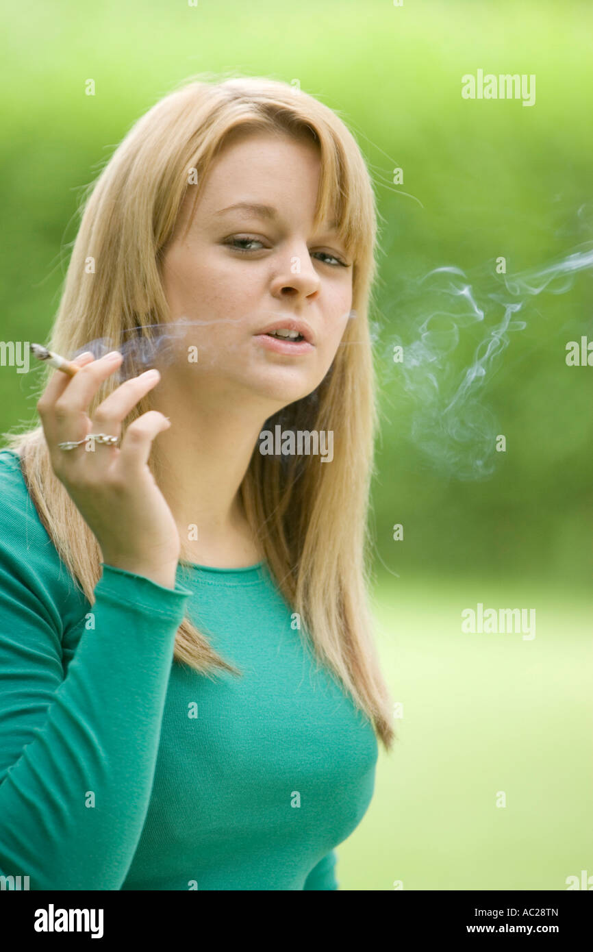 Casually, Young blonde teen smoking cigarette