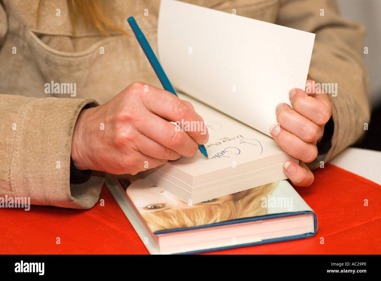 Toyah Willcox signing a copy of her new book at Fowey  Festival Fowey Cornwall UK May 2006 - Stock Image