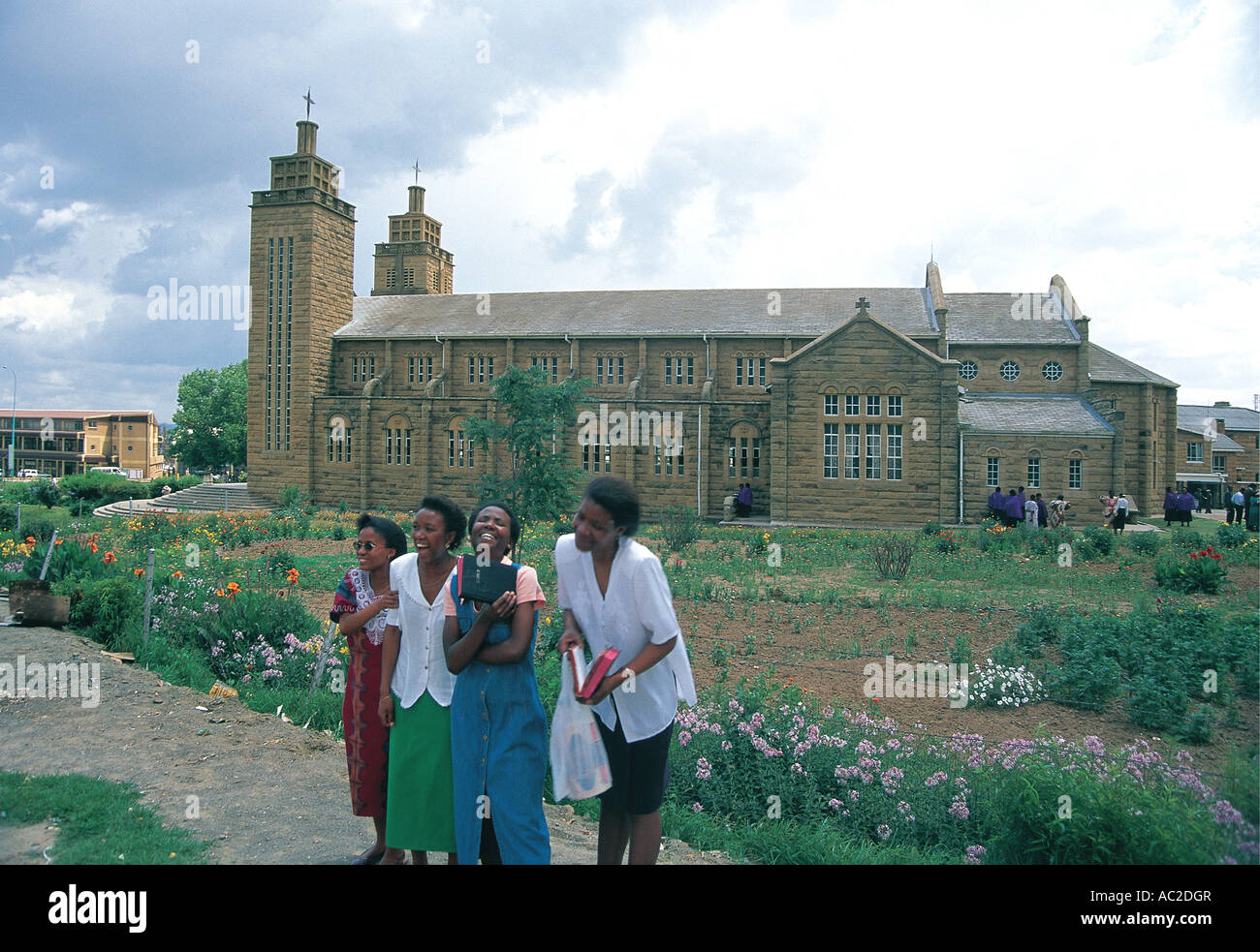 Church goers outside their church happy after services Maseru capital of Lesotho - Stock Image