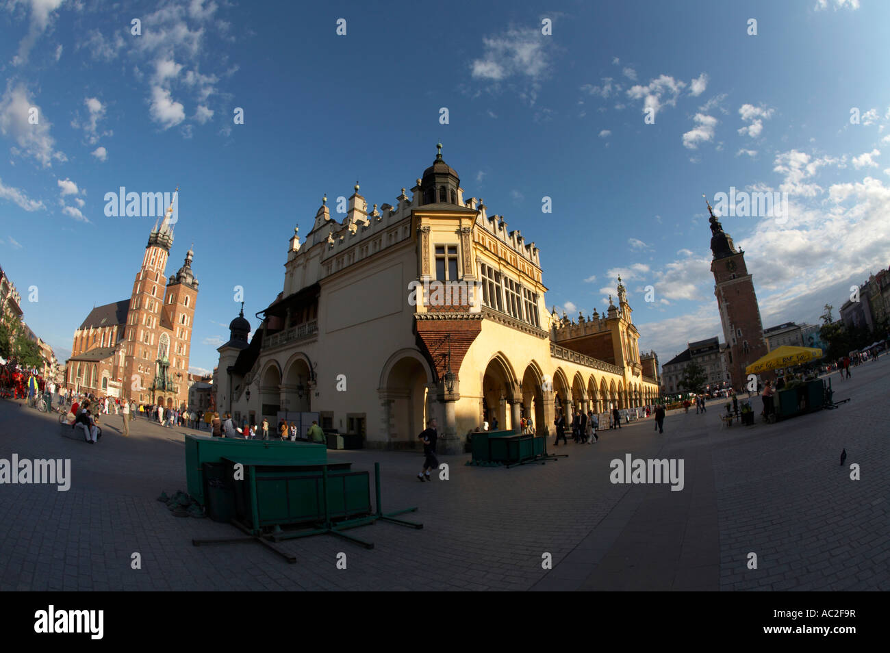 fisheye of Rynek Glowny main town square in the stare miastro cloth hall town hall tower and basilica of the Virgin - Stock Image