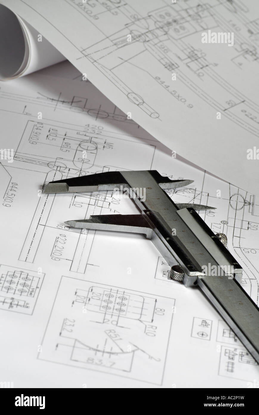 Vernier Callipers and Design Blueprints - Stock Image