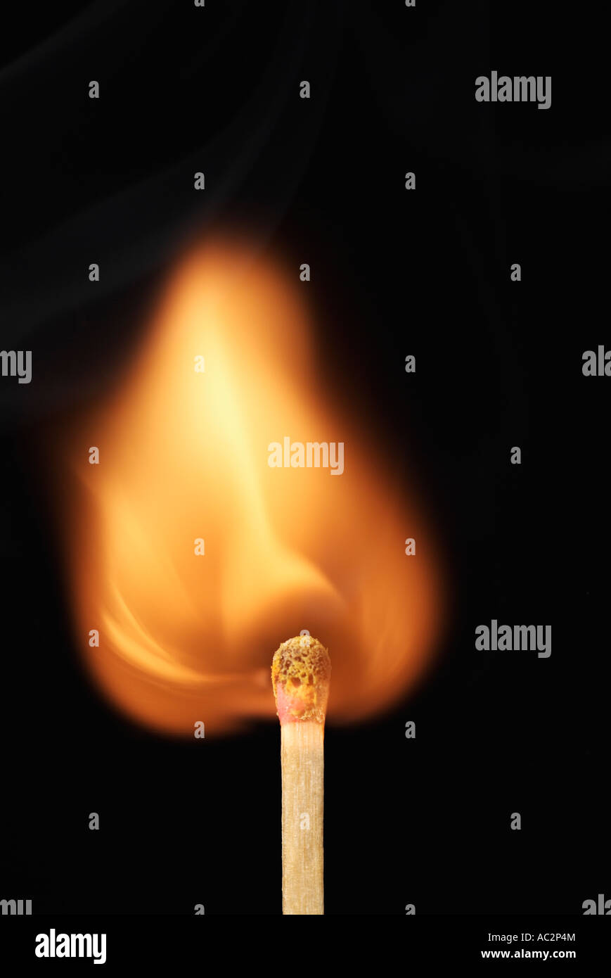 Lit Match with a Flame Flaring Up After Being Struck Stock Photo