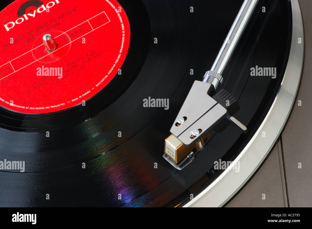 LP vinyl music record spinning on the turntable - Stock Image