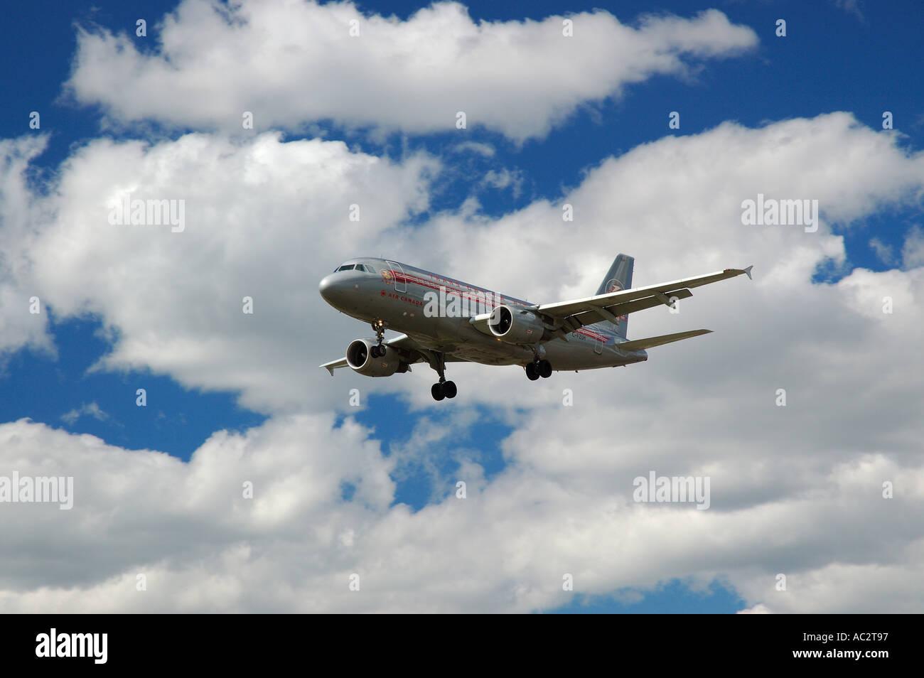 Classic Air Canada Trans Canada Airlines jet flying in clouds - Stock Image
