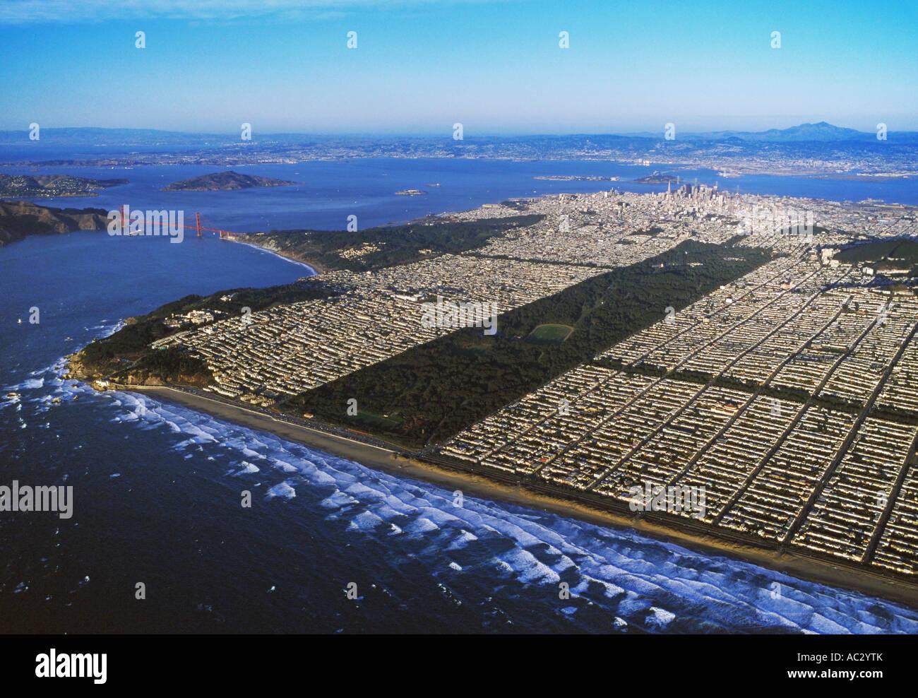 aerial overview above San Francisco's Ocean Beach, Golden Gate park, the Golden Gate bridge, Lands End, the - Stock Image