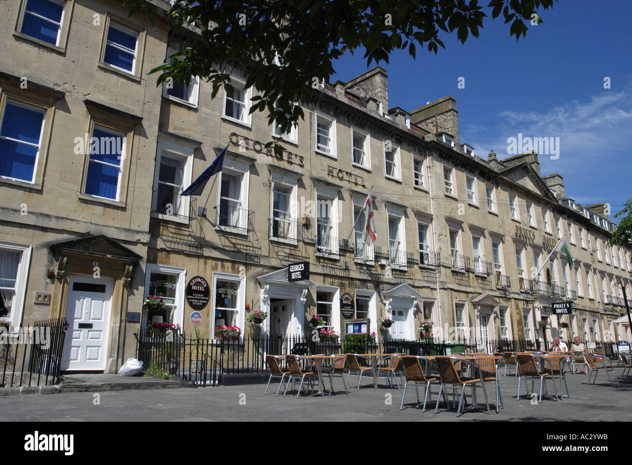Bath England the Georges Hotel with open air cafe tables and chairs on pavement Bath Somerset UK - Stock Image