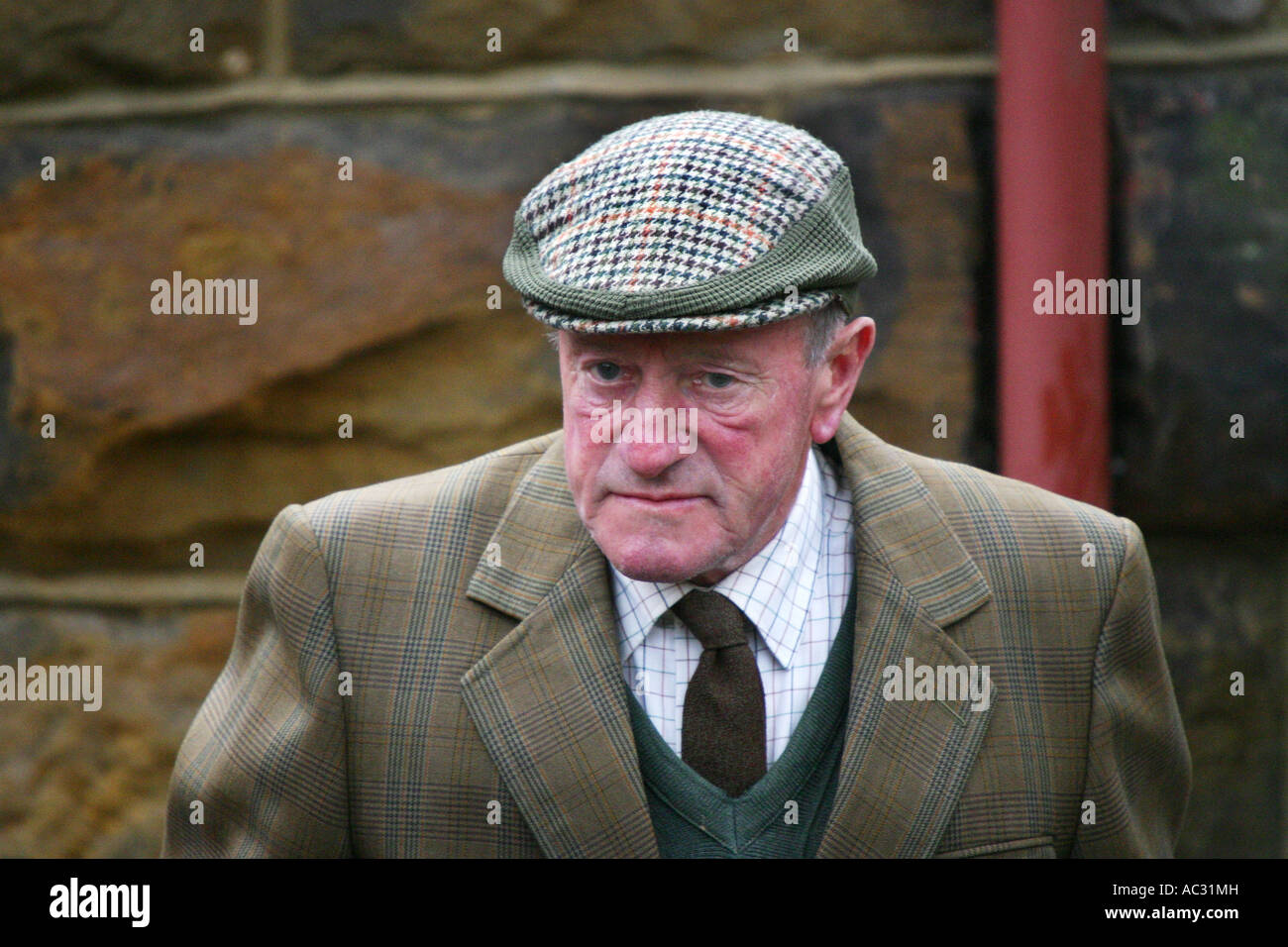 Old man wearing a flat cap as extra actor in ITV series Heartbeat ... c42c8ec85d9