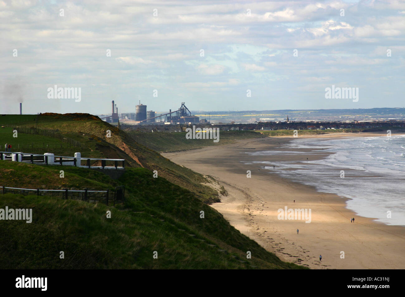 The blast furnace and steelworks on the east coast at Redcar viewed from the pier at Saltburn. - Stock Image