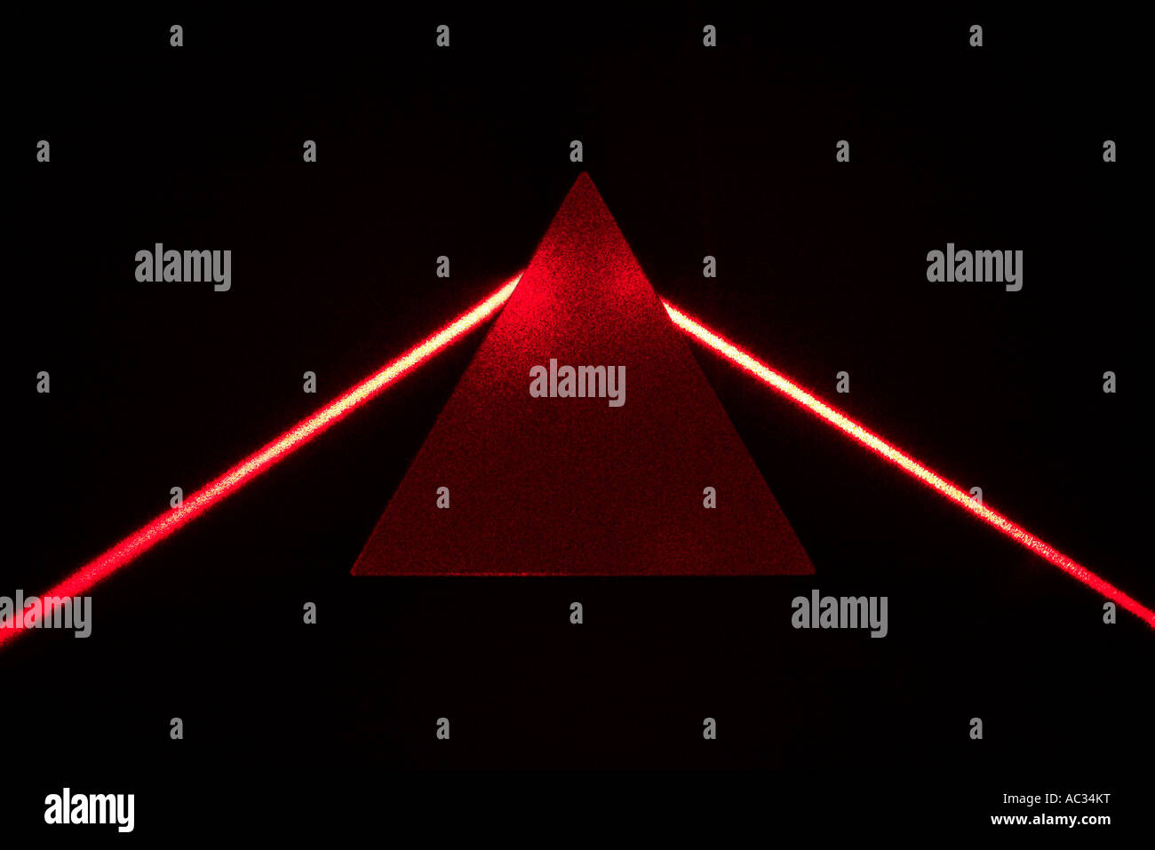 Equilateral prism deflecting red laser beam - Stock Image