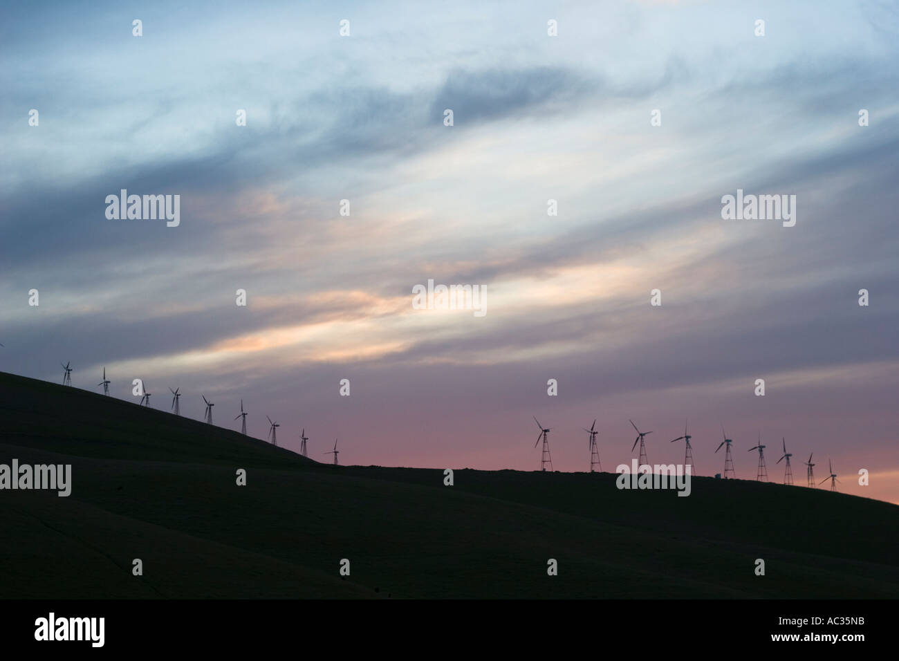 Windmills at Altamont Pass Wind Resource Area at dusk, Alameda County , California, USA Stock Photo