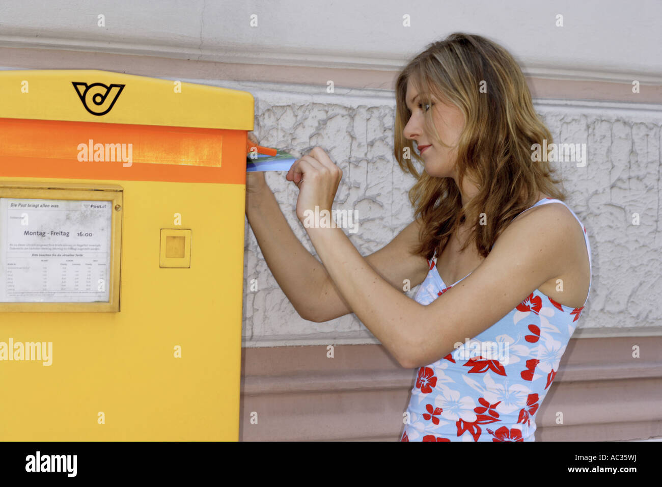 young woman in front of a letterbox, Austria Stock Photo
