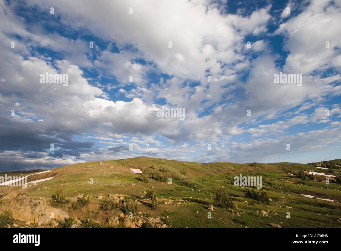 Partly cloudy blue sky above Emigrant Pass in the Emigrant Wilderness Area California, USA. - Stock Image
