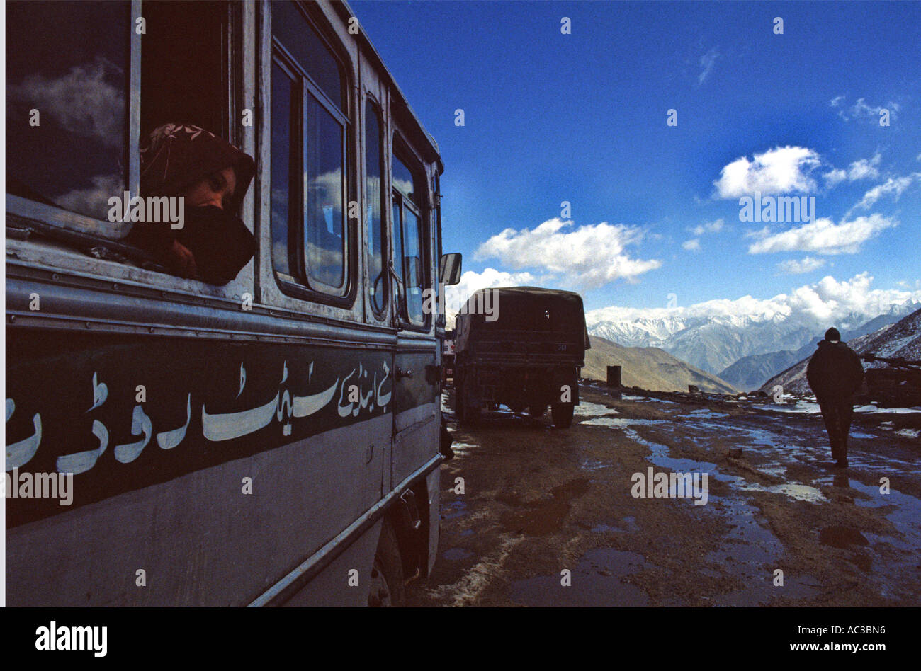 Girl on a bus on High mountain pass in the Indian Himalayas - Stock Image