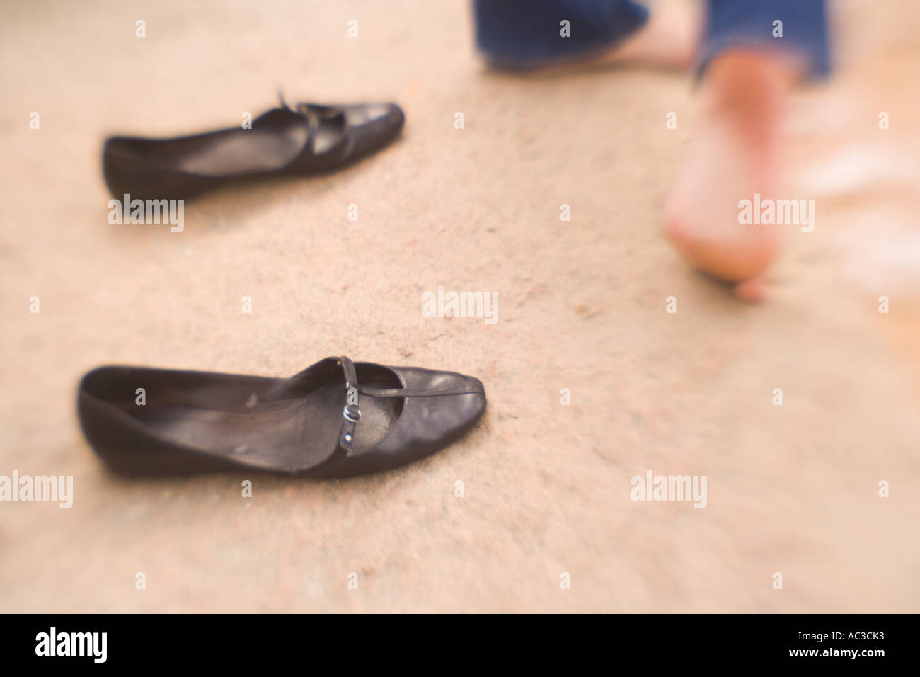 Woman Who s Left Her Shoes Behind - Stock Image