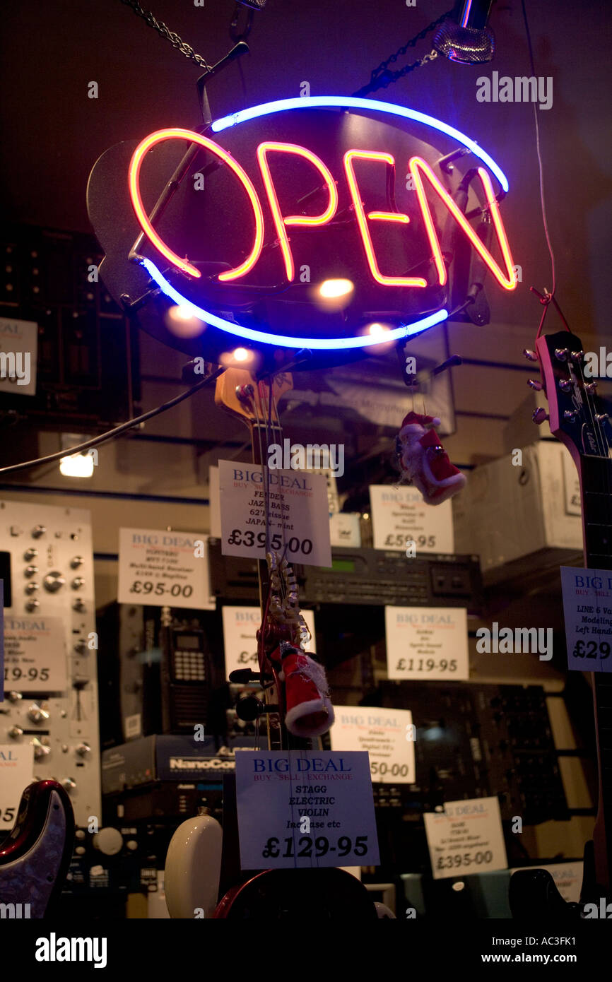 """""""Open Neon Sign"""" in the Front """"Shop Window"""" of a """"Guitar Shop"""", Stock Photo"""