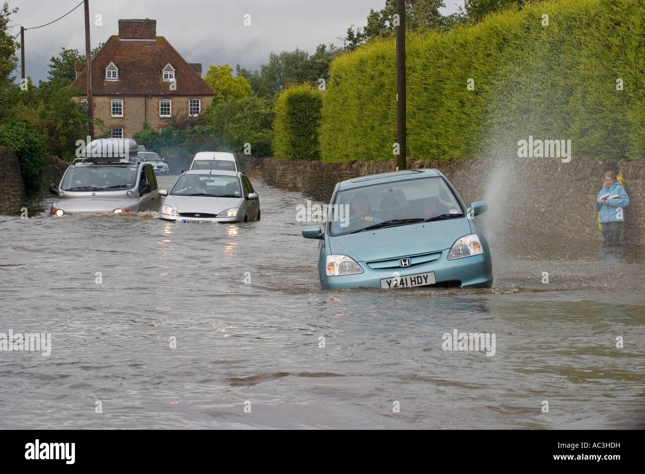 Cars in the floods - Stock Image