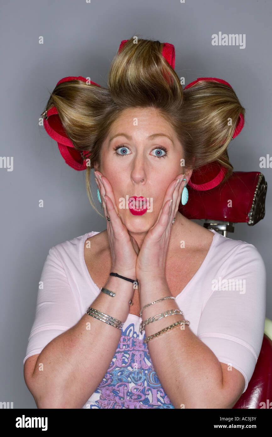 eighties 80's retro humor hair salon image of woman in curlers people white background Stock Photo