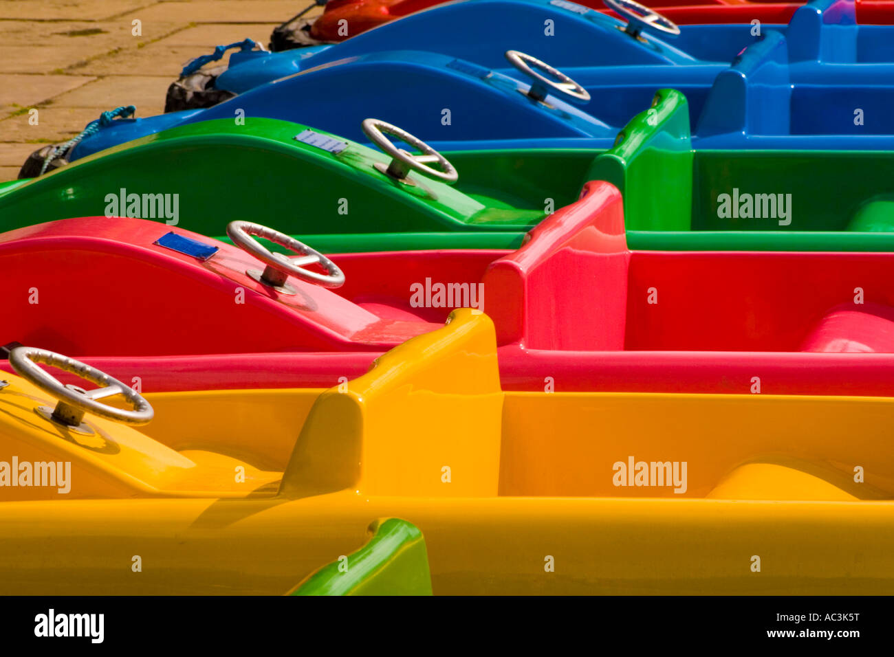 Line of brightly colored boats on the river Dee in Chester - Stock Image