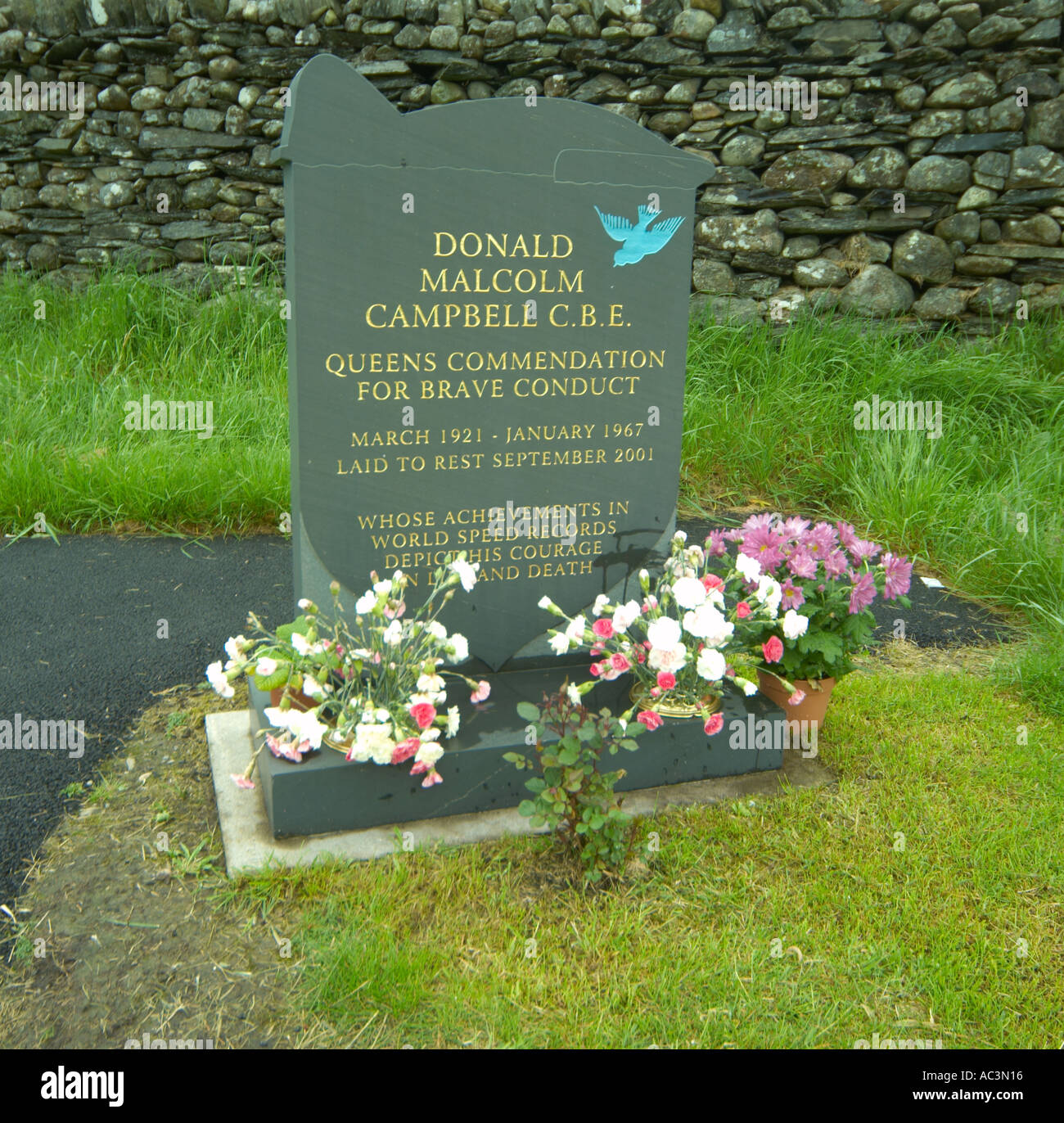 Grave Of Donald Campbell CBE Land and water speed record holder who died on Coniston water on the 4th of January 1967,Coniston Cumbria UK - Stock Image