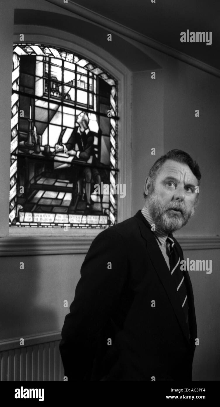 terry waite cbe ex hostage and the john bunyan stained glass window which the postcard come from - Stock Image