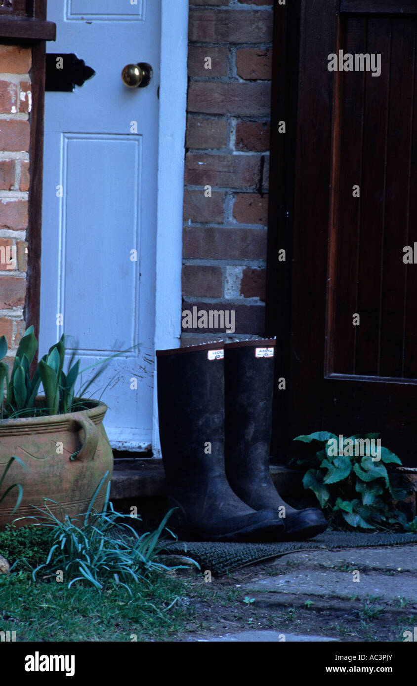Wellington Boots Outside Country Cottage in the uk - Stock Image