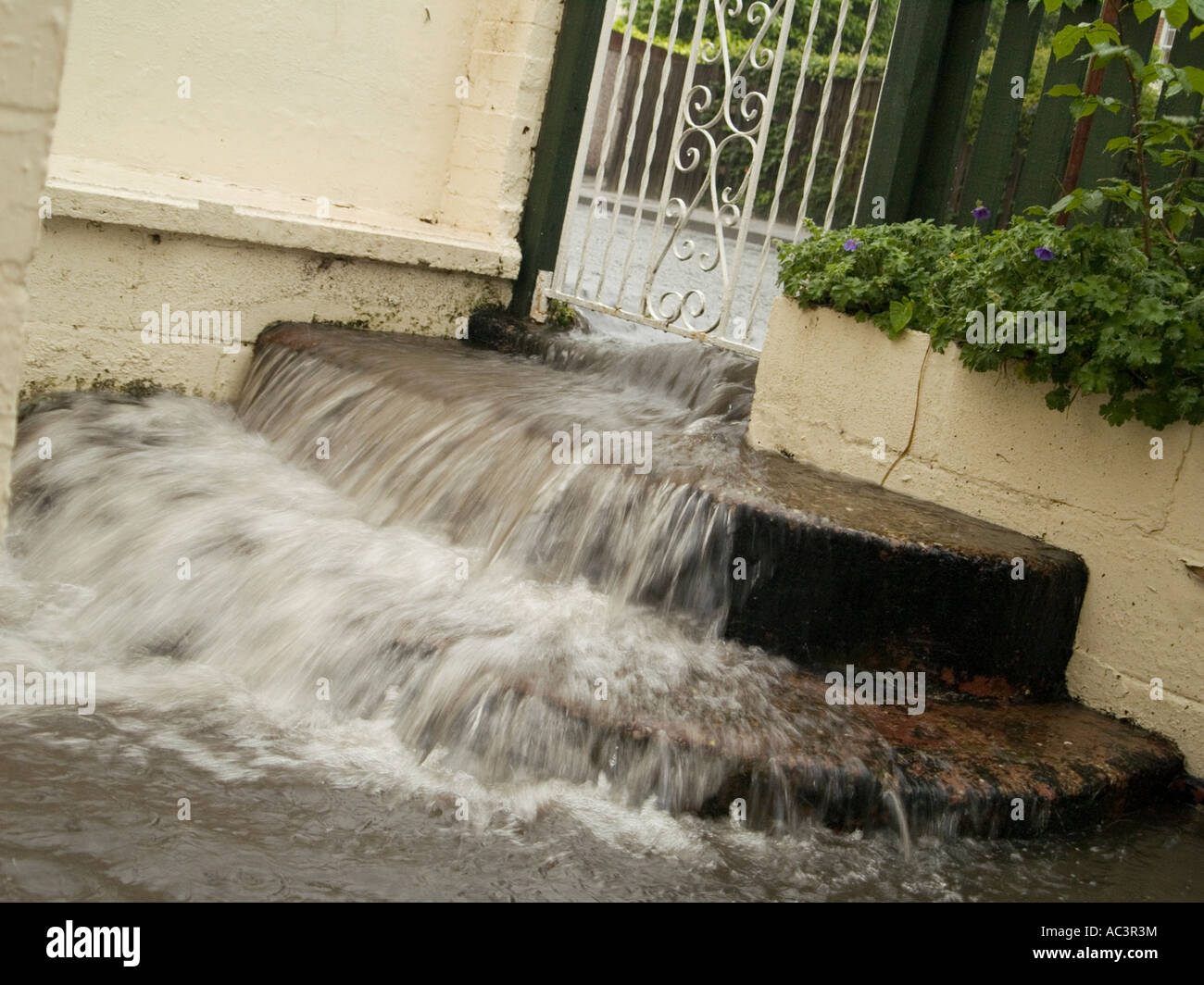 Flood Waters Flowing Down Steps in a Domestic Garden, Nottingham UK 2007 Stock Photo