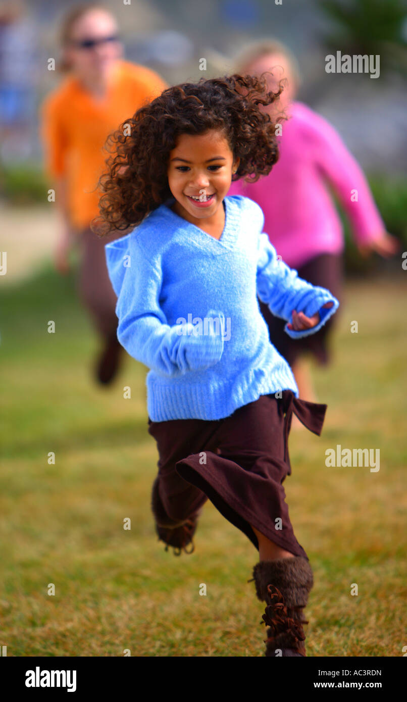 Little Girl Running on Grass at Mussel Shoals Carpenteria Santa Barbara County California United States MR - Stock Image