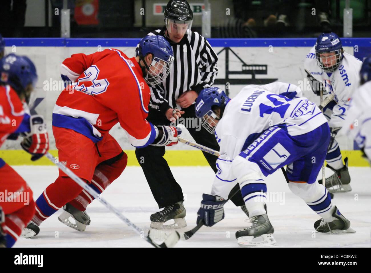 Face off between Finland and the Czech Republic in an international tournament for 17 year old teenagers. - Stock Image