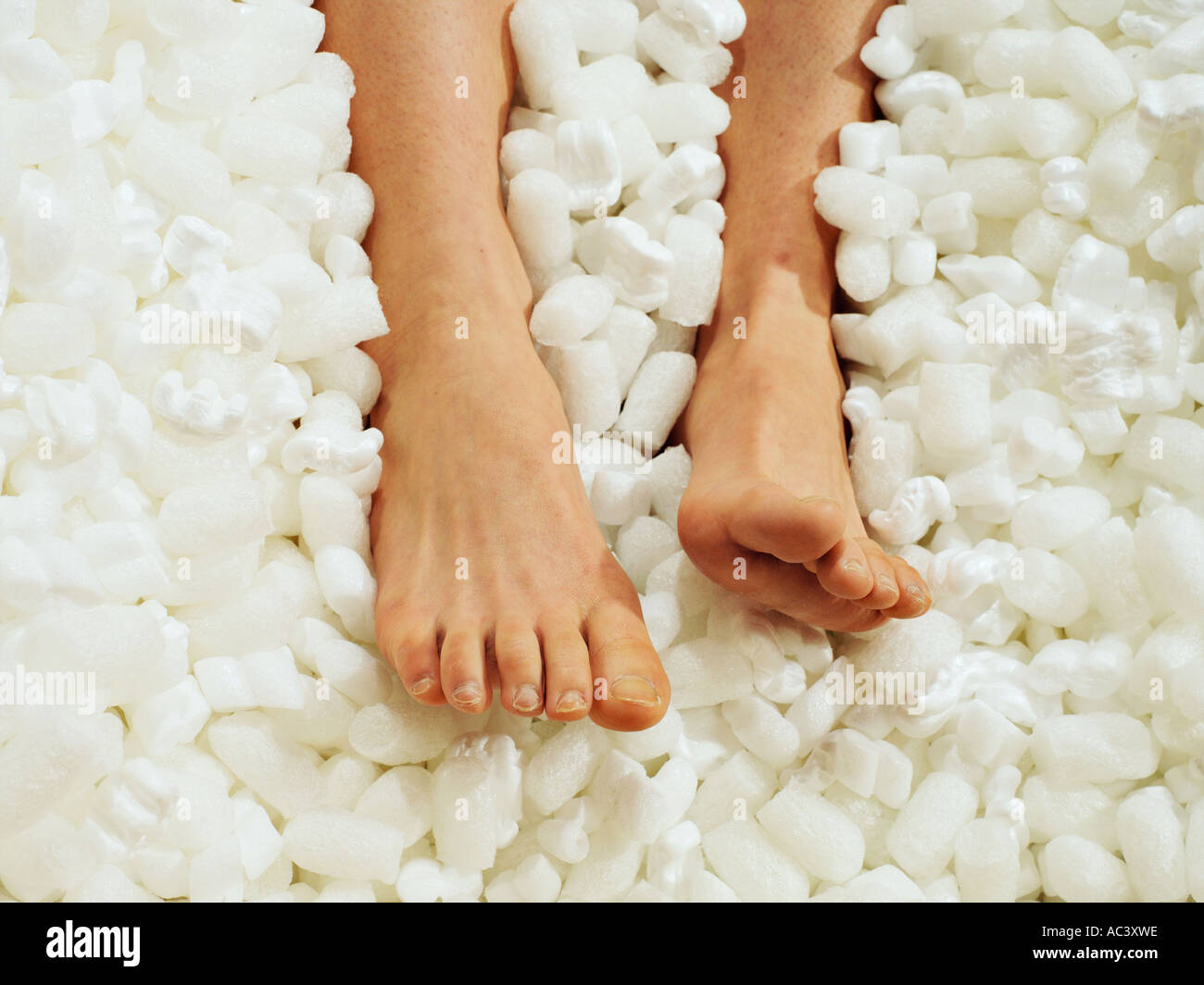 A pair of packaged feet - Stock Image