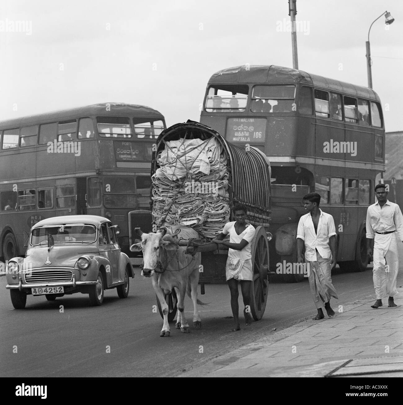Old street scene of ox cart old london buses and morris for Old black and white photos for sale