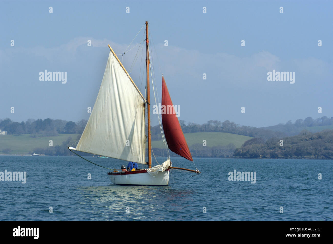 A traditional oyster dredger sailing boat at work in Carrick Roads in the Fal estuary Cornwall England Stock Photo