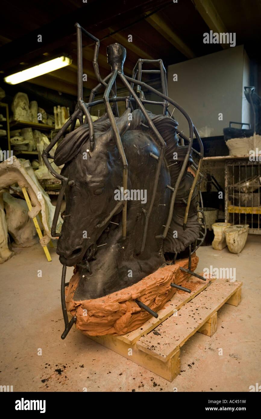 A waxwork mould of an equestrian statue section before casting. Moule en cire d'une portion de statue équestre - Stock Image