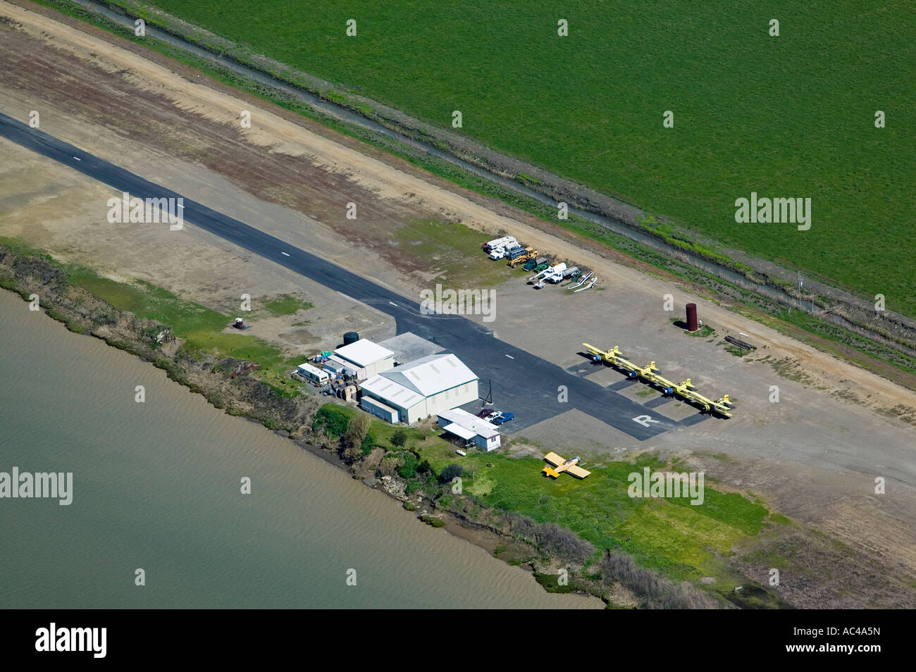 aerial above San Joaquin valley, California crop dusting airport strip; restricted private airport with Ag Cats Stock Photo
