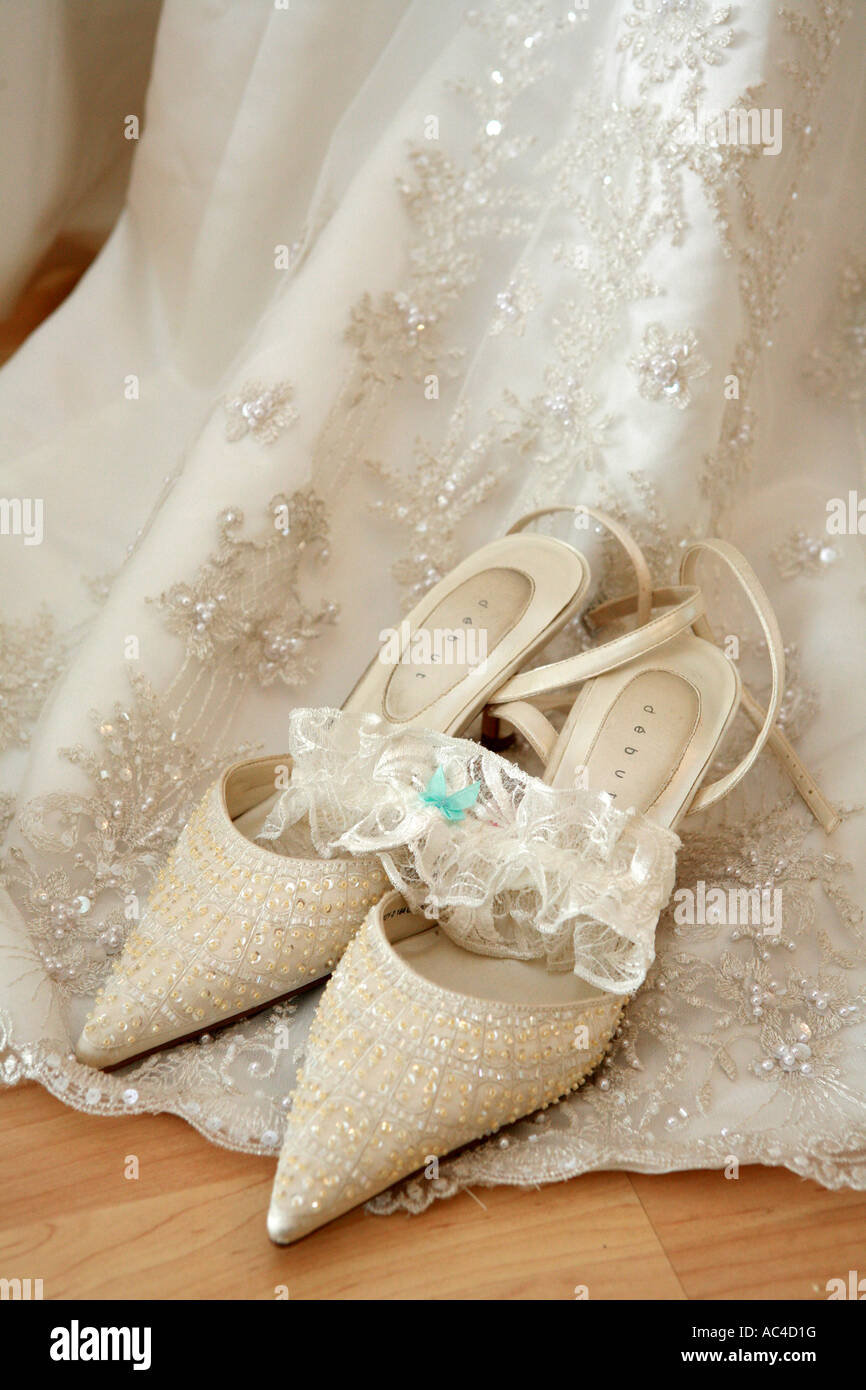 Expensive Bridal Wedding Shoes Resting On Wedding Dress With