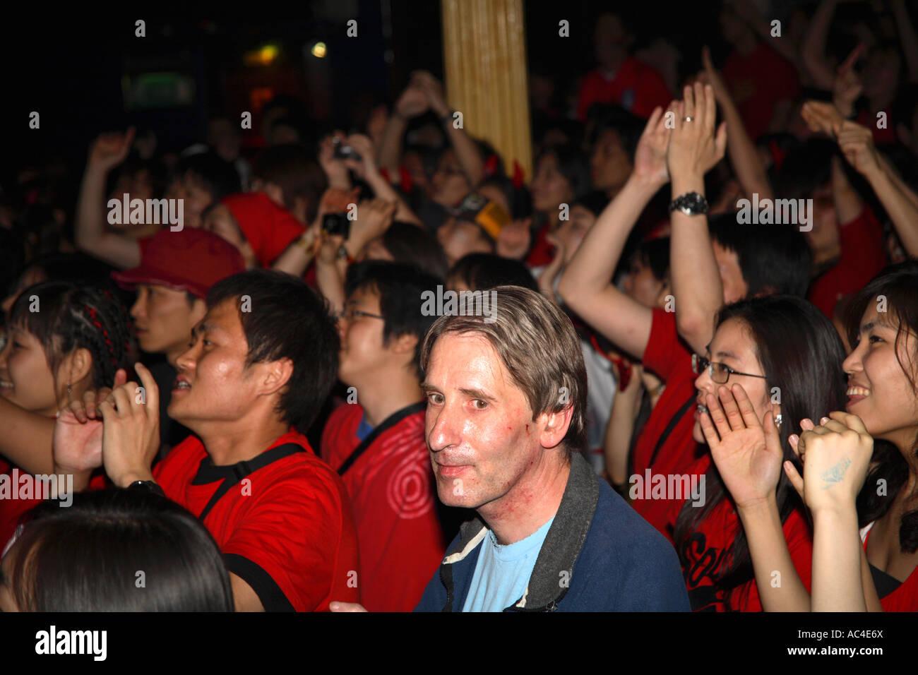 western guy sitting amongst south korean republic fans watching