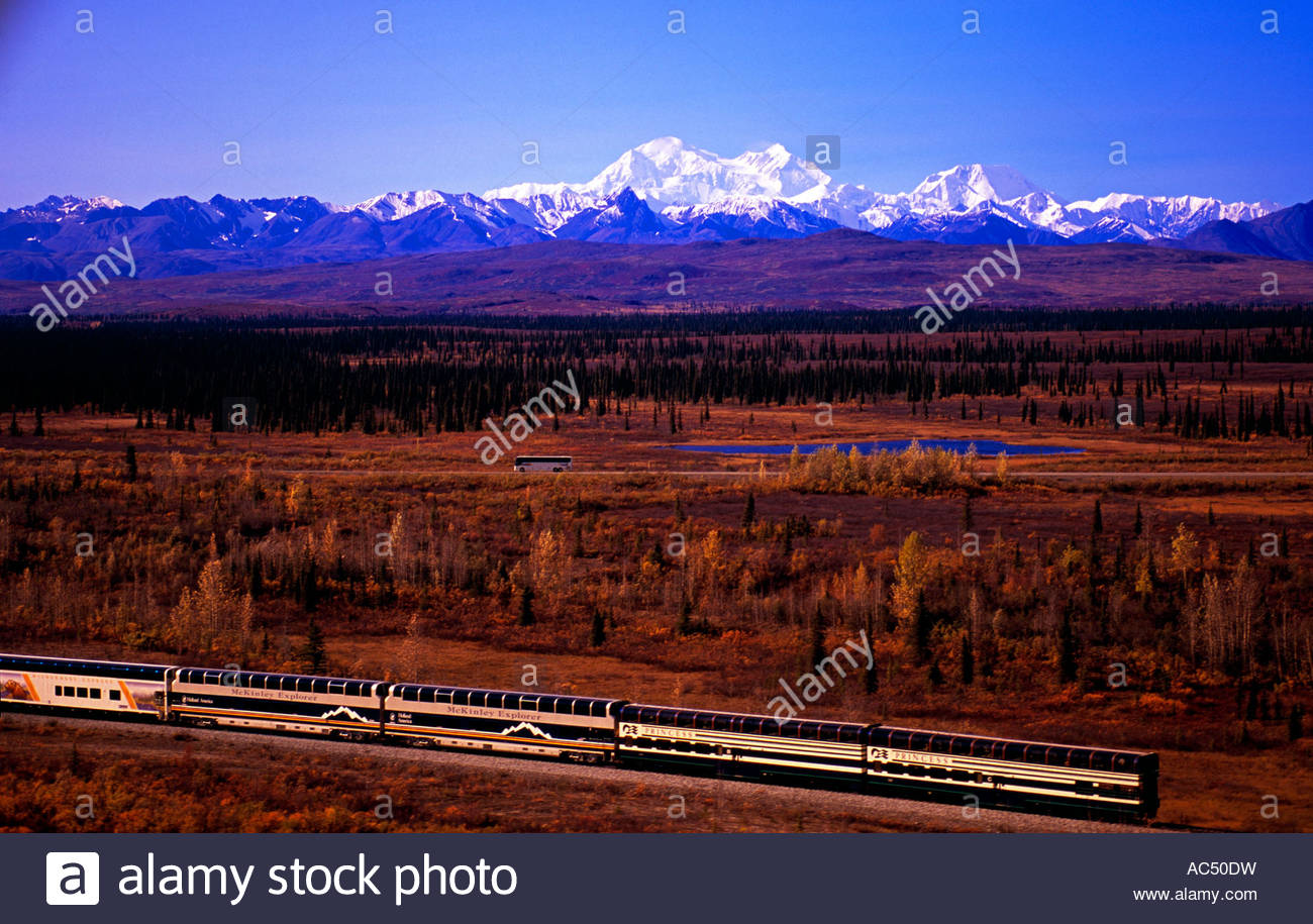 Alaska Railroad train with Mount McKinley and the Alaska Range in the back - Stock Image