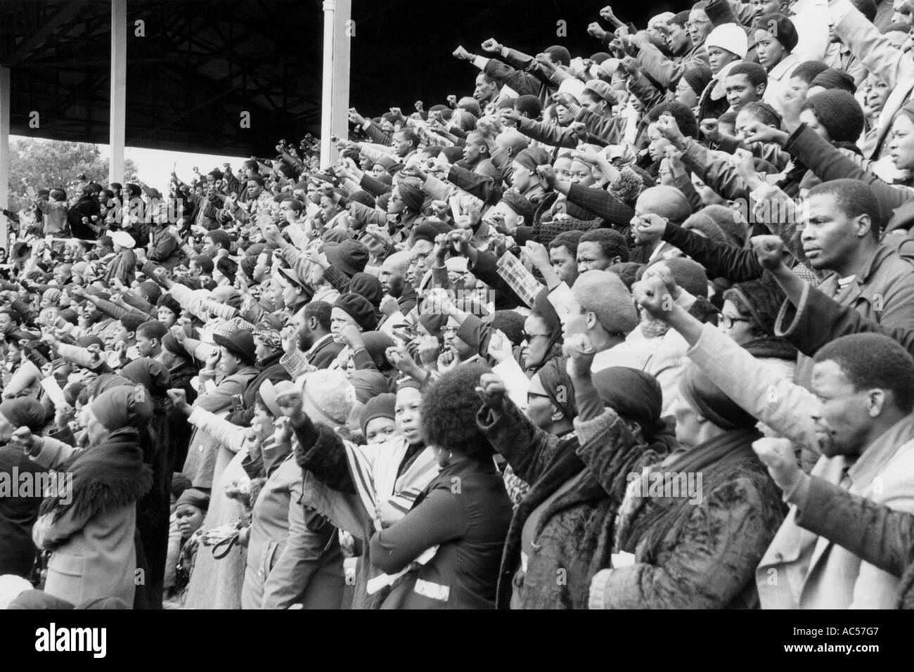 Black Power salutes at football match in South Africa 1976 - Stock Image
