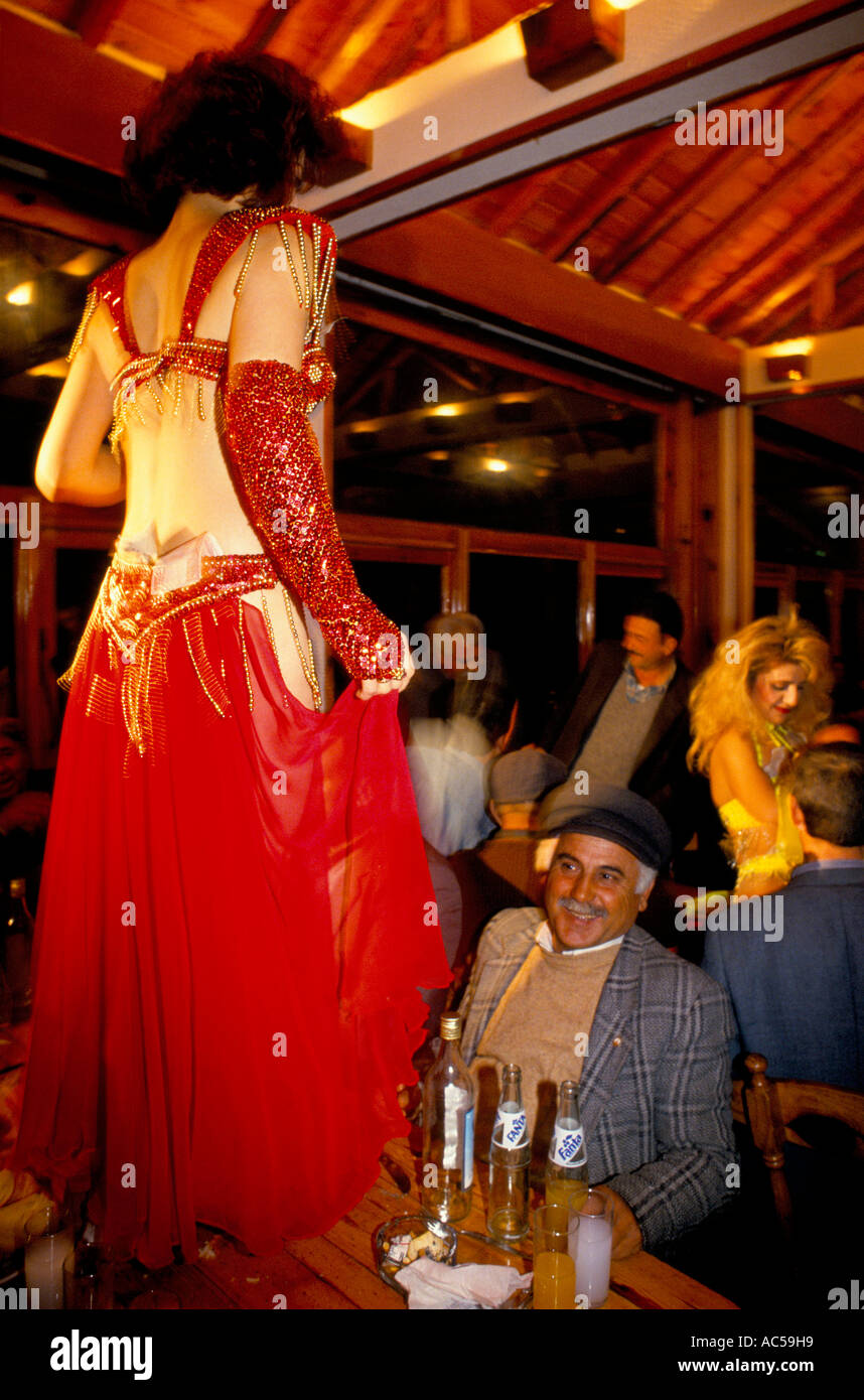 CAMEL WRESTLING EPHESUS: BELLY DANCER AT CAMEL OWNERS DINNER, 1994   Stock  Image