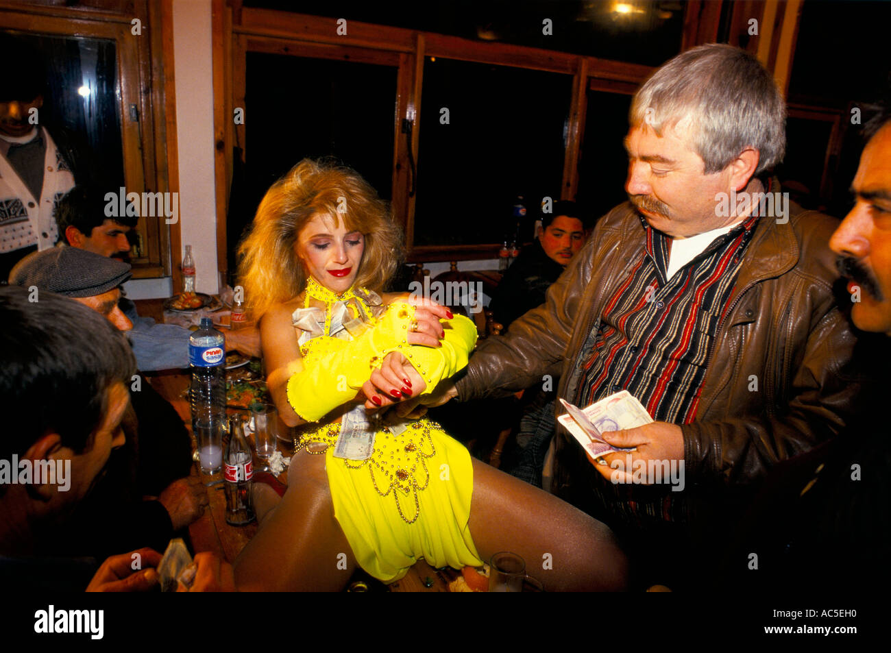 BELLY DANCER RECEIVES MONEY FROM MAN CAMEL OWNERS ANNUAL DINNER EPHESUS  TURKEY 07 1993   Stock
