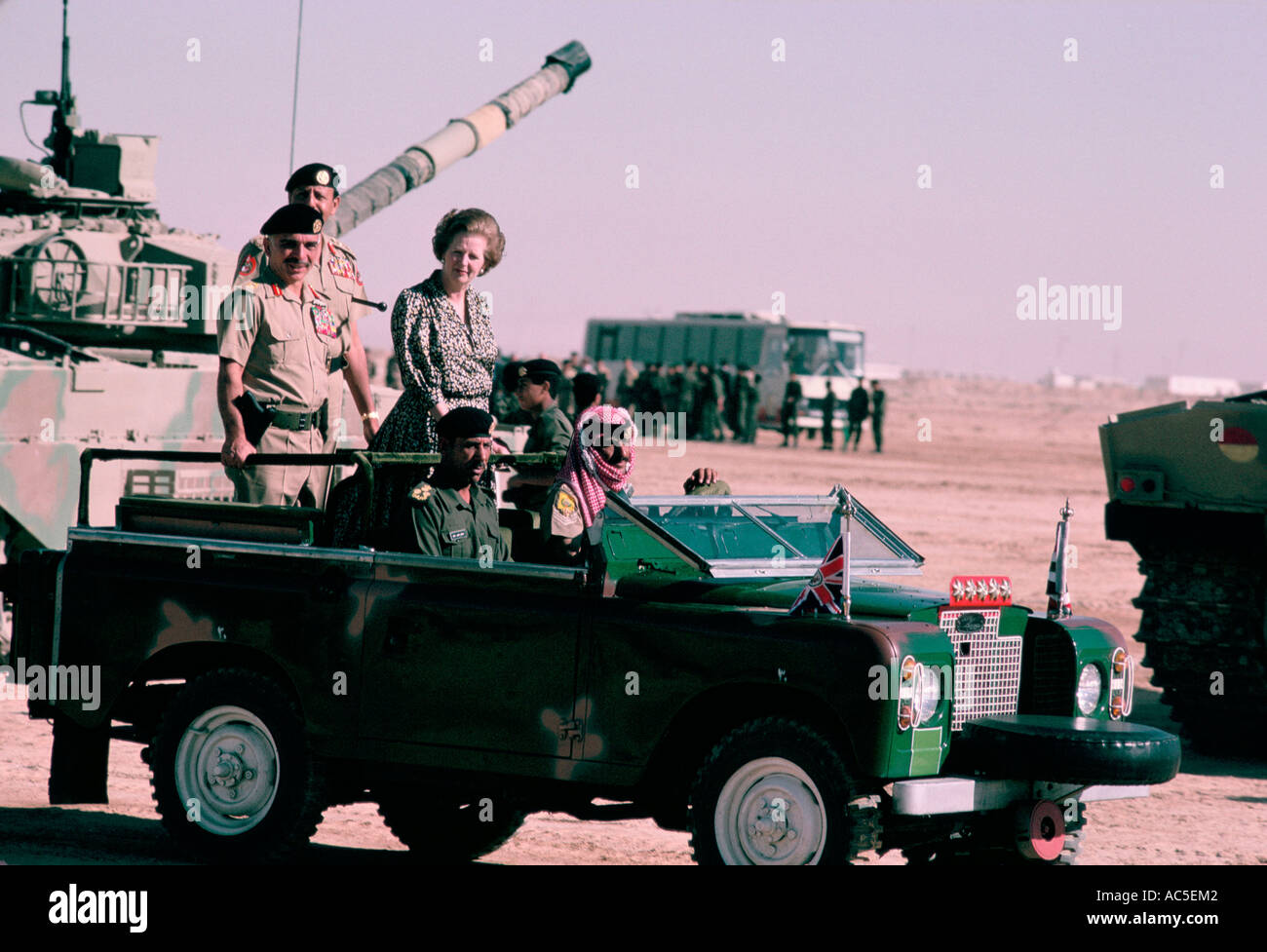 MARGARET THATCHER WITH KING HUSSEIN IN A MILITARY OFFICIAL JEEP JORDAN 1985 - Stock Image