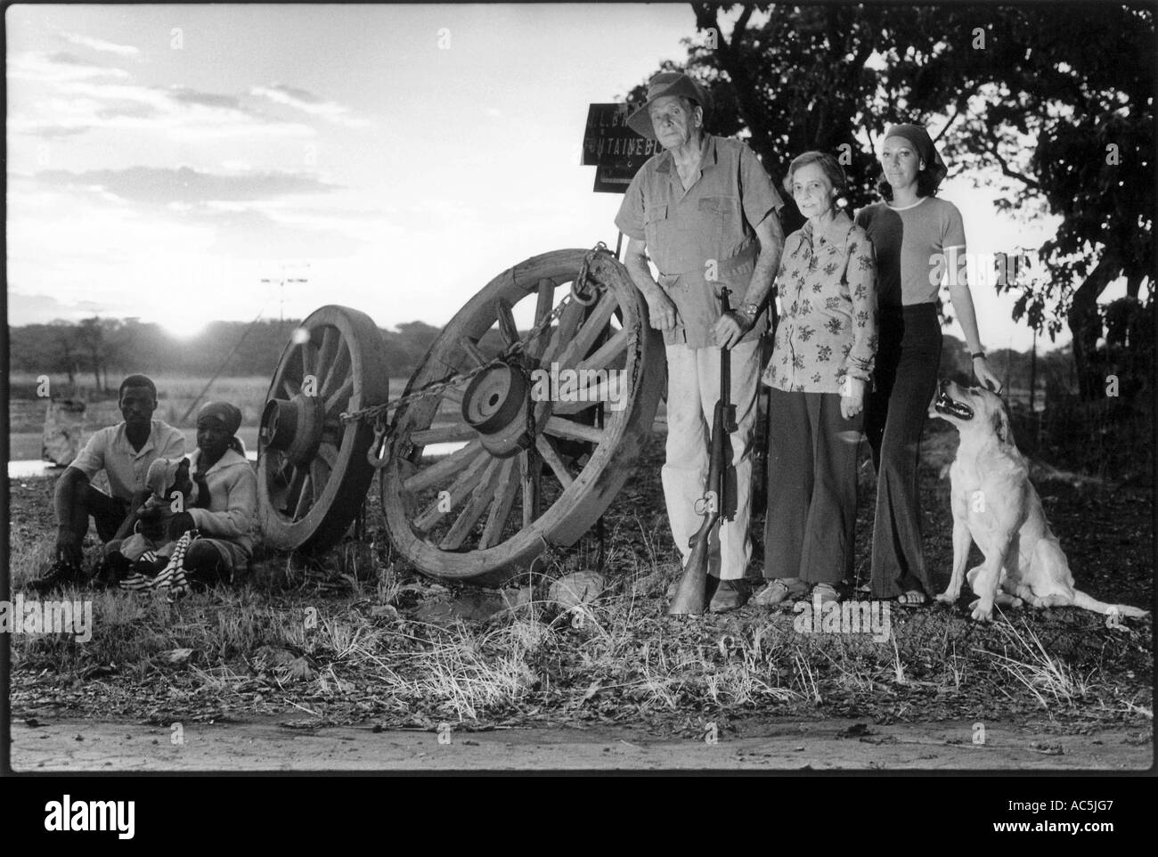Rhodesian  pioneer farmers outside their farm near (Salisbury) Harare.The wagon wheels are all that is left from the trek. - Stock Image