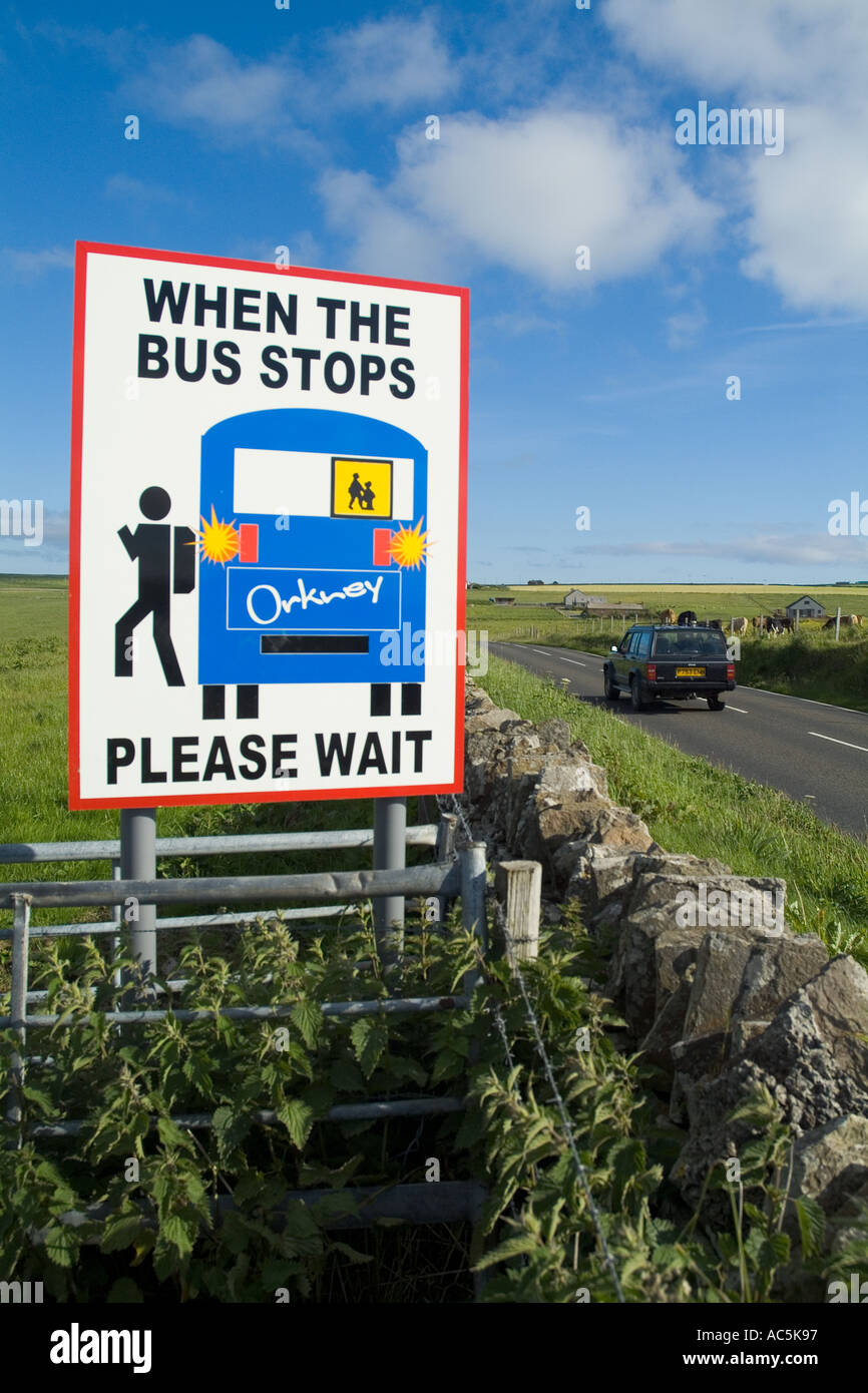 dh Bus stop ST OLA ORKNEY Safety school traffic warning sign displayed at side main road with car Stock Photo