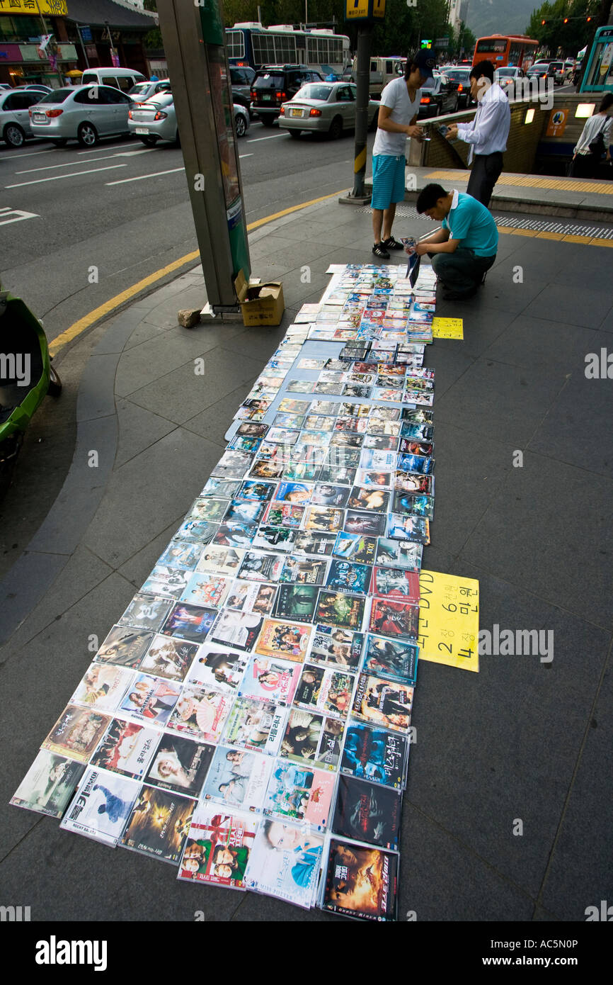 Vendor Selling Counterfeit Bootleg DVD Movies on the Street Seoul