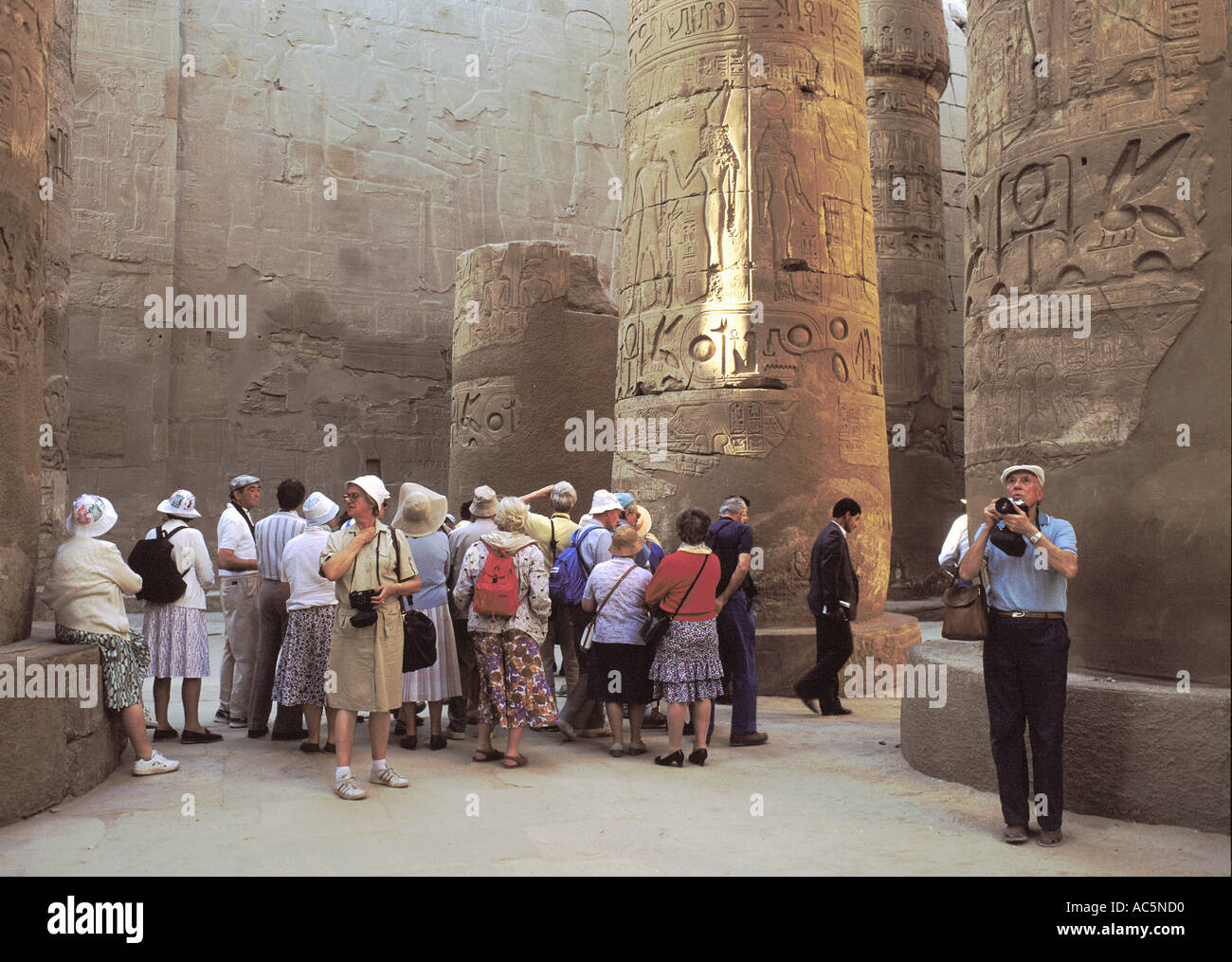 Tourist group in the Hypostyle Hall of Karnak, Luxor, Egypt - Stock Image