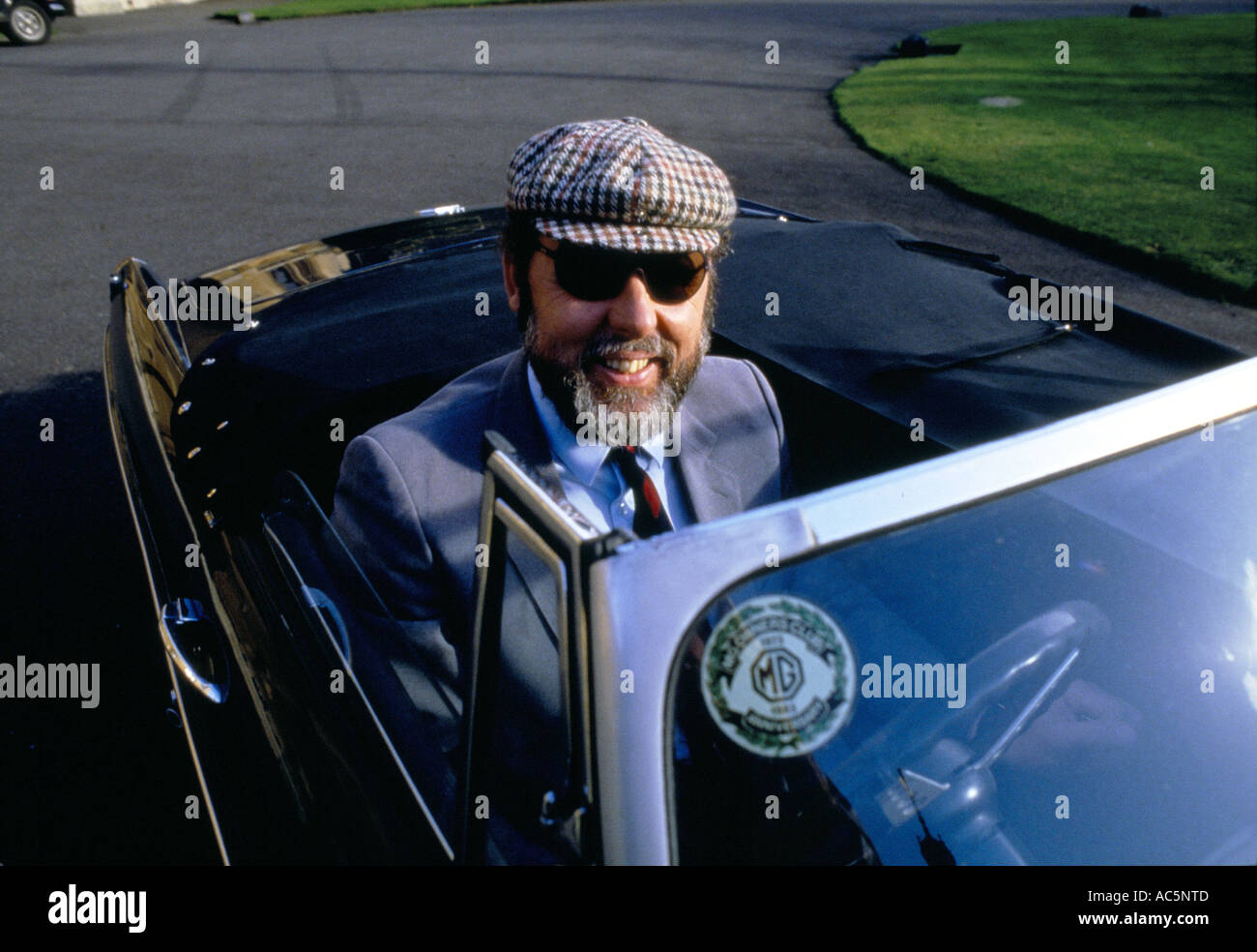 Terry Waite with his MG sports car smiling He is a British humanitarian best known for his work as a hostage negotiator - Stock Image