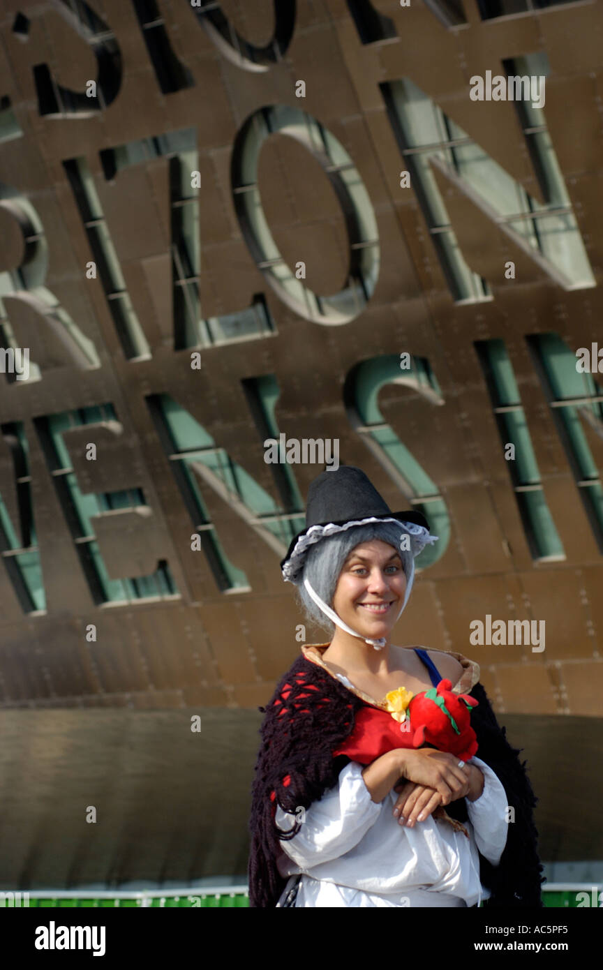 d3f24dfc7 Woman in traditional Welsh costume outside Millennium Centre, Cardiff Bay,  Wales - Stock Image