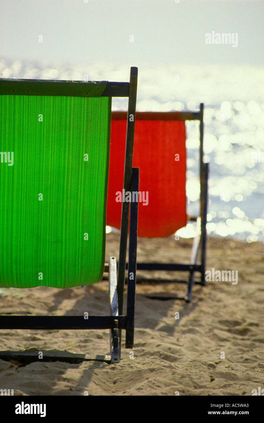 two beach chairs in Tel Aviv Israel two beach chairs Tel Aviv Israel Mediterranean Outdoors sun Day Sand Seat Vacation Stock Photo