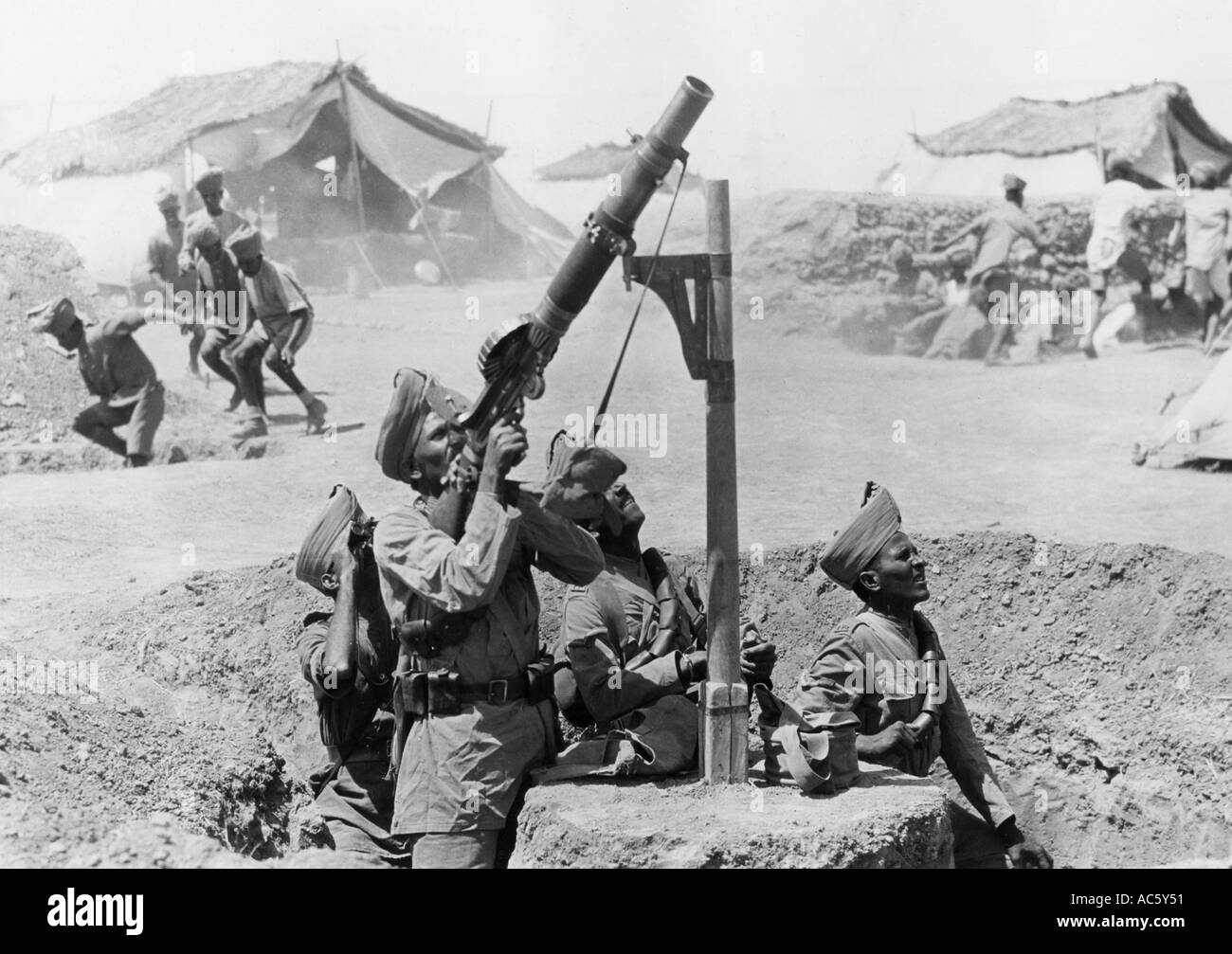 WWI Indian troops use a pole mounted Lewis gun against German aircraft in Palenstine in 1918 as others dive for cover - Stock Image