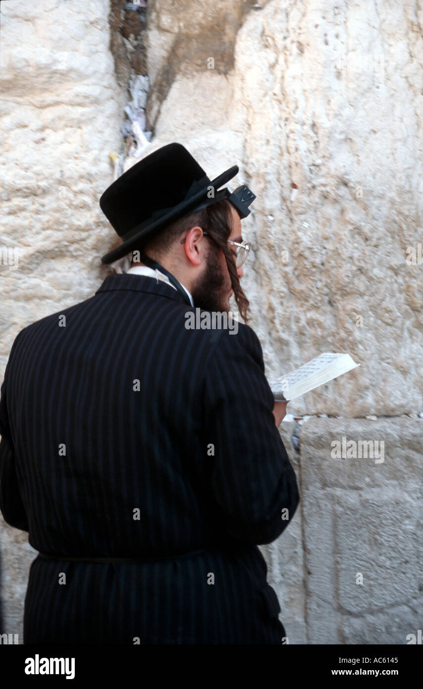 Worshiper at Western Wall in Jerusalem Israel - Stock Image